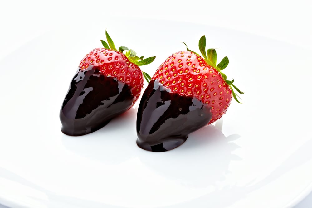 Five strawberries dipped in two squares melted good quality dark chocolate = 100 calories