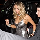 Jennifer Lawrence in a silver slip dress and diamond jewelry for Rihanna's Met Gala afterparty.