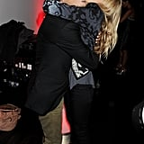 Sienna Miller and Matthew Williamson share a bear hug.