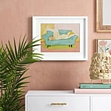 Woman on Couch With Cat Framed Wall Art