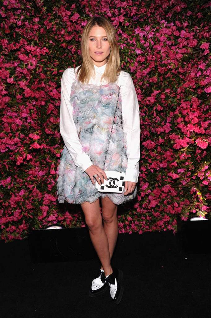 Dree Hemingway layered up in a white blouse and a colorful textured minidress, complete with a Chanel mini bag, at a Chanel dinner in NYC.