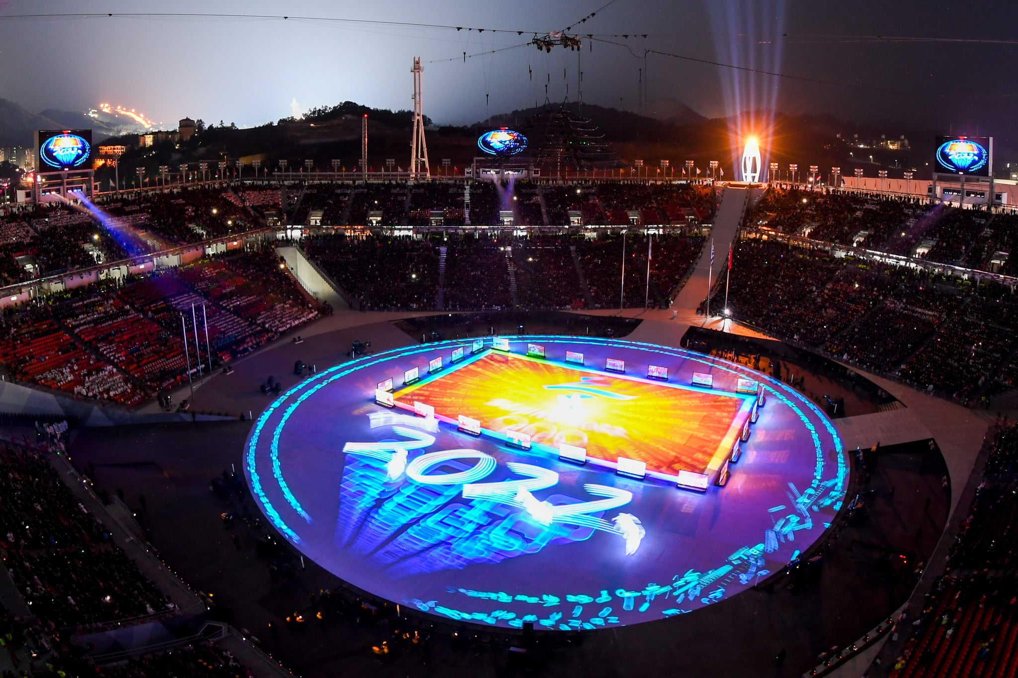 General view shows Beijing 2022 projected on stage during the closing ceremony of the Pyeongchang 2018 Winter Olympic Games at the Pyeongchang Stadium on February 25, 2018.The 2022 Winter Olympic Games will be held in Beijing. / AFP PHOTO / François-Xavier MARIT        (Photo credit should read FRANCOIS-XAVIER MARIT/AFP/Getty Images)