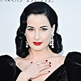 Dita Von Teese wore bold dangling pearl earrings.
