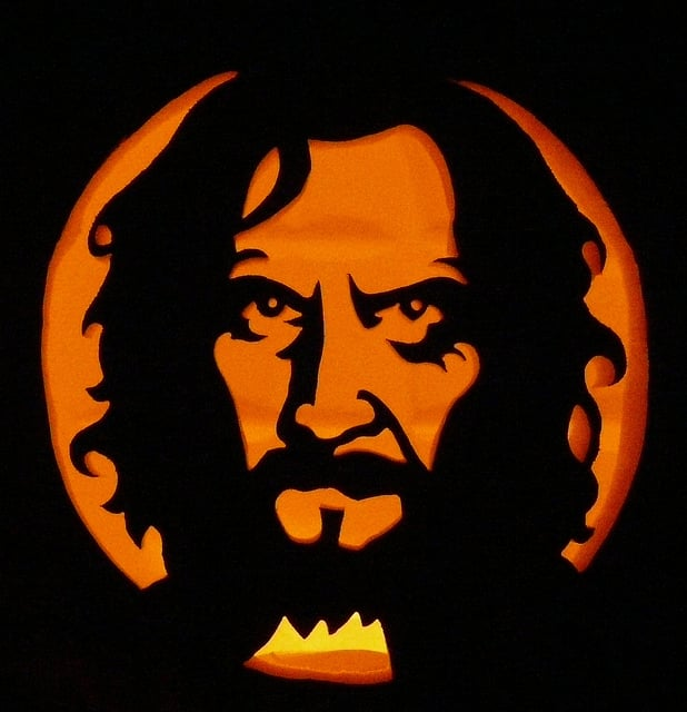 harry potter pumpkin carving templates - sirius black looks ever so serious with a candle behind