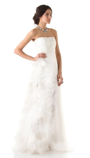 Reem Acra's strapless silk organza gown ($7,800) is simple up top, but all about the frothy bottom half.