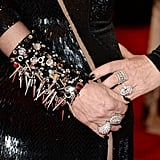 Donatella Versace wore a spiked black cuff and diamond rings.