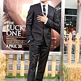Zac Efron attended The Lucky One premiere in LA looking dapper in a black shiny suit.