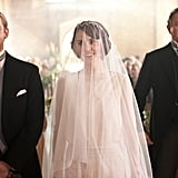 The happy couple stands with Robert at the wedding. Source: PBS