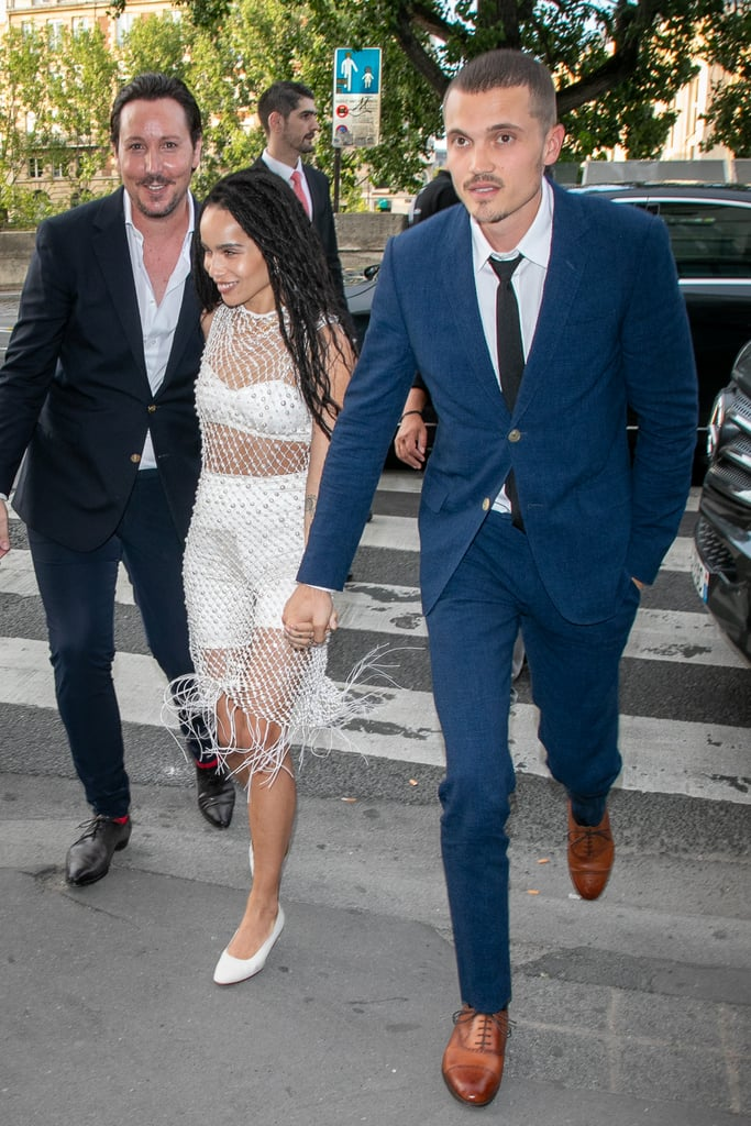 "Zoë Kravitz and Karl Glusman are getting ready to say ""I do"" for the second time! Ahead of their weekend wedding, the couple held a rehearsal dinner at Laperouse restaurant in Paris on Friday. Zoë and Karl were joined by their family and friends, including her parents Lenny Kravitz and Lisa Bonet, Chris Pine, Denzel Washington, and Cara Delevingne, as well as Zoë's Big Little Lies costars Reese Witherspoon, Laura Dern, and Shailene Woodley. The 30-year-old actress exuded cool in a pair of biker shorts and a white fishnet dress, while her beau looked sharp in a blue suit.  Zoë and Karl — who first met through mutual friends in 2016 — surprised everyone with their secret wedding in May; however, they're now planning to have a traditional ceremony this weekend in France. ""It'll be a trip and emotional for all the reasons anybody would understand,"" Lenny recently told People about his daughter's big day. See photos from the star-studded rehearsal dinner ahead!      Related:                                                                                                           Who Is Zoë Kravitz's Fiancé? 5 Things to Know About Actor Karl Glusman"