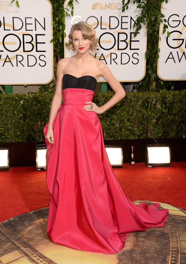 "Taylor Swift took a big departure from her usual, sparkly look and wore Carolina Herrera at the 2014 Golden Globe Awards in LA on Sunday. The singer was nominated for best original song for ""Stranger Than Fiction,"" though she didn't win in her category tonight. Taylor also has quite a history with the Globes and tonight's hosts, Tina Fey and Amy Poehler. Last year, when the funny ladies hosted the show for the first time, Taylor made headlines when she slammed the comedians for making a light-hearted joke at her expense about her hitting on Michael J. Fox's son. Amy and Tina never apologized for Taylor's joke, and the singer never brought up the diss after her initial comment. Be sure to vote for your favorite Golden Globes fashion and beauty moments in our polls!"