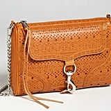 The tanned leather and whipstitch detail remind us of a traditional horse saddle — one Western staple we could never pass up. Rebecca Minkoff 'MAC' Perforated Whipstitch Shoulder Bag ($395)