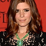 Kate Mara accented her sideswept waves with a heavily lined eye-makeup look.