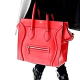 Céline's iconic luggage tote dipped in a bright red hue.