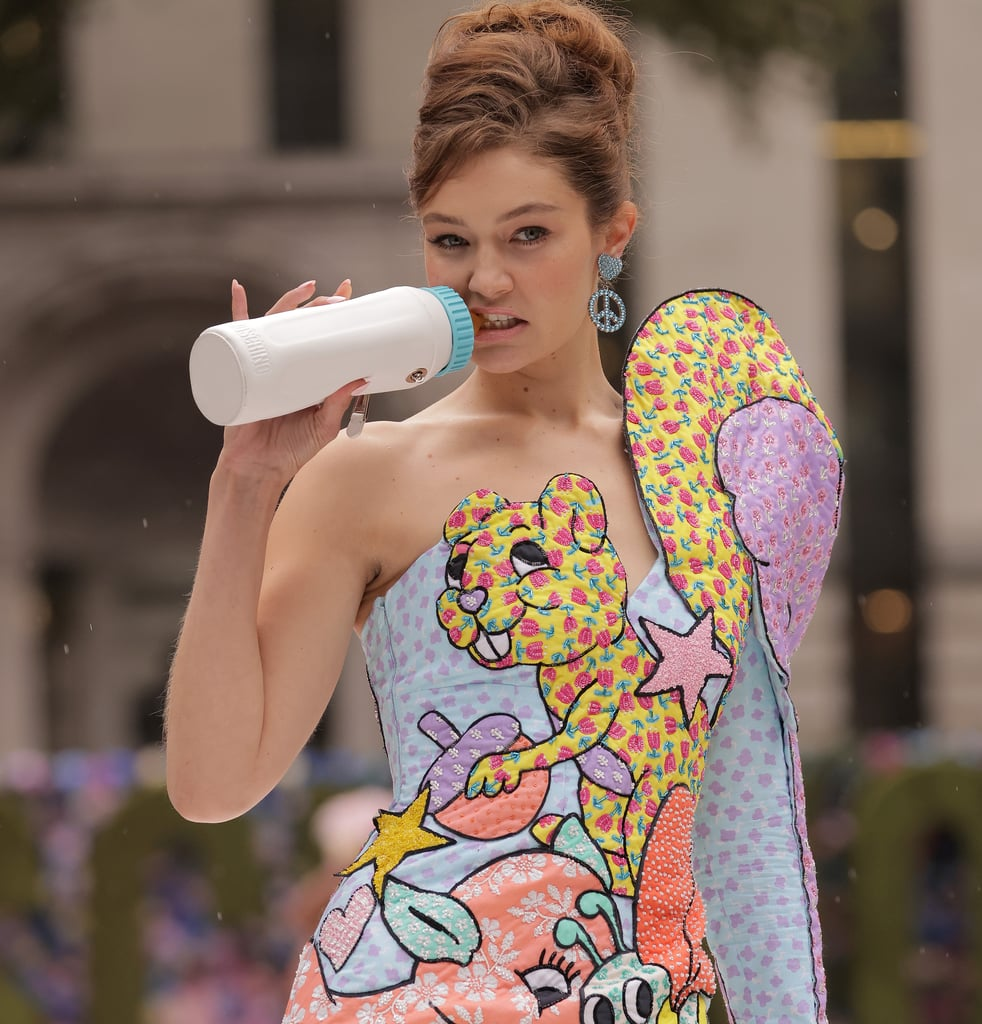 Gigi Hadid Holds a Baby Bottle on the Moschino Runway
