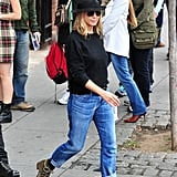 Her slouchy, rolled jeans looked cool with a sweater and a fedora in September 2011.