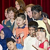 Kate and Will got together for a group photo with cute kids and their teachers during a visit to Singapore's Rainbow Center in September 2012.