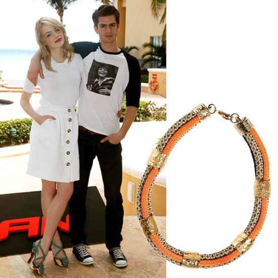 We love Emma Stone's cool take on white Dolce & Gabbana separates, but to spice things up, add a colorful tribal-inspired collar necklace under the Peter Pan collar for a sweet mix of shapes and dimension.