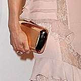 We love that Lucy Liu's clutch looks almost rose gold against her pink gown.