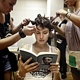 Backstage at Leanne Marshall's Spring 2013 show, a model read Lennon Remembers: The Full Rolling Stone Interviews From 1970 by Jann S. Wenner.