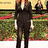 Julia's tailored Givenchy jumpsuit, which she styled with peep-toe pumps and Tiffany & Co. jewels for the 2015 SAG Awards, is still one of our favourite looks to date.