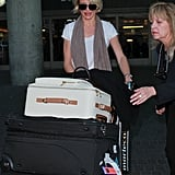 Cameron Diaz pushed her bags.