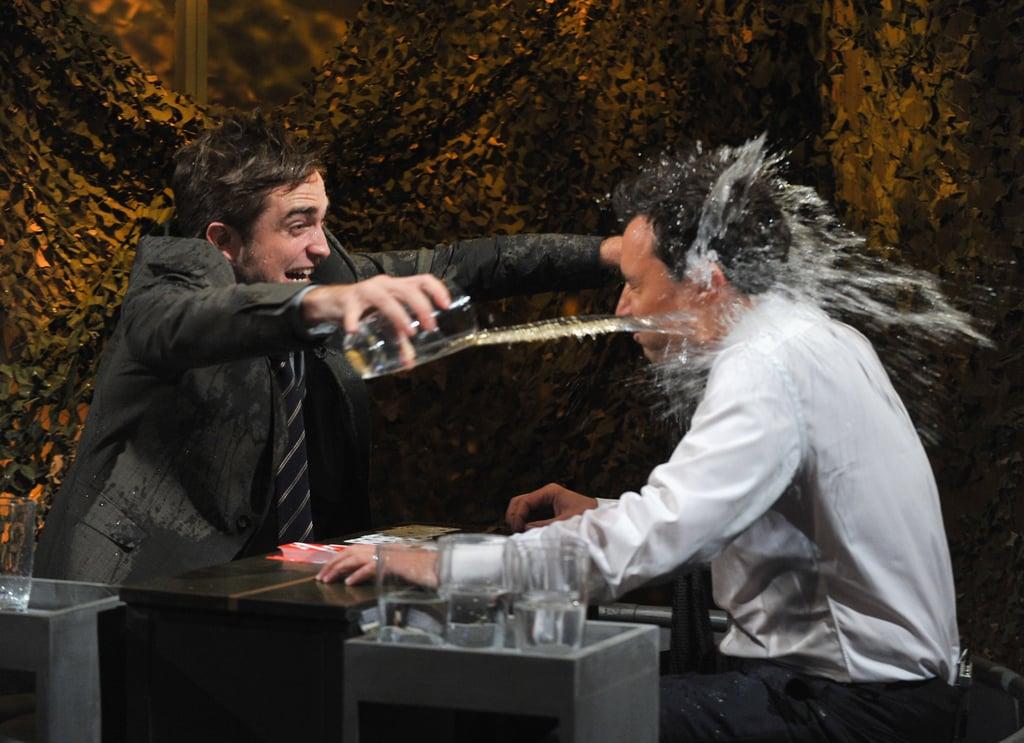 Robert Pattinson threw water on Jimmy Fallon in NYC.