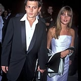 Wearing a white strapless shift dress, with Johnny Depp in 1995.