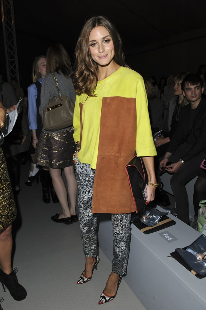 Olivia Palermo turned up in the front row of Unique in a unique take on neon, print, and suede.