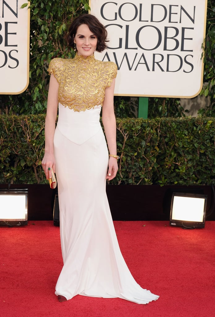 Michelle Dockery brought Downton to Los Angeles when she attended the 2013 Golden Globes in LA on Sunday night. She wore a gold-and-white Alexandre Vauthier dress featuring a high collar. Michelle is nominated for best actress in a TV drama for her role on Downton Abbey against Connie Britton, Glenn Close, Claire Danes, and Julianna Margulies. This is Michelle's first Golden Globe nomination. Share your thoughts on Michelle's regal look in our Golden Globes red-carpet fashion polls.