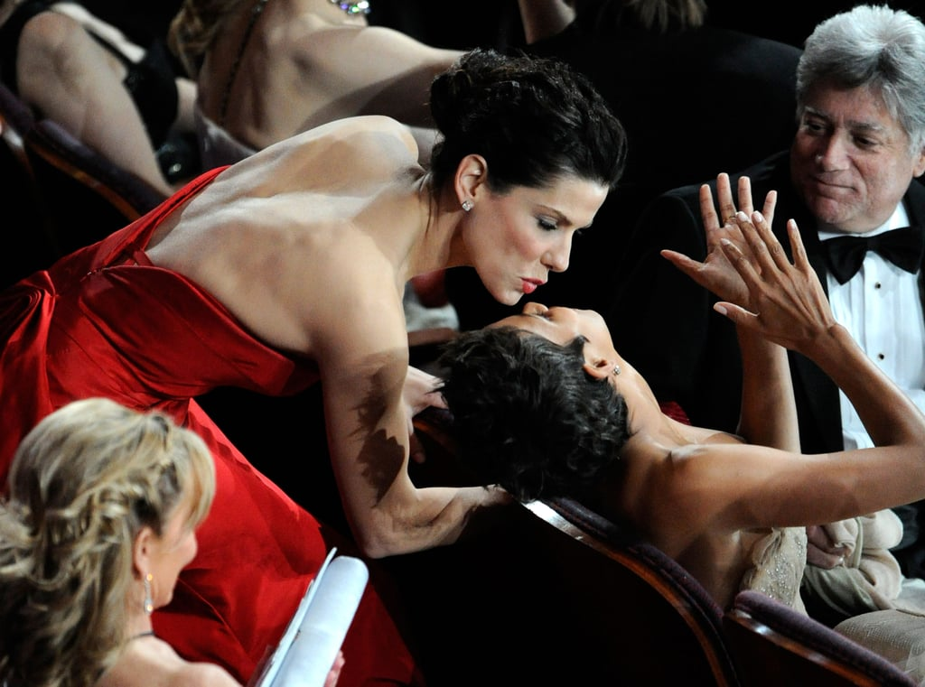 Halle Berry got a kiss from Sandra Bullock during the February 2011 Oscar presentation in LA.