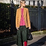 For work, layer one under a blazer and embrace a mixed color palette.