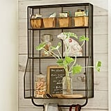 Hang this wall-mounted organizer ($129) in your garage or on the deck for attractive and convenient outdoor storage.