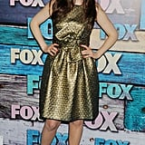 She never discourages a standout bow detail, and her gold metallic jacquard Paule Ka cocktail dress from a Fox Summer party certainly fit the mold.