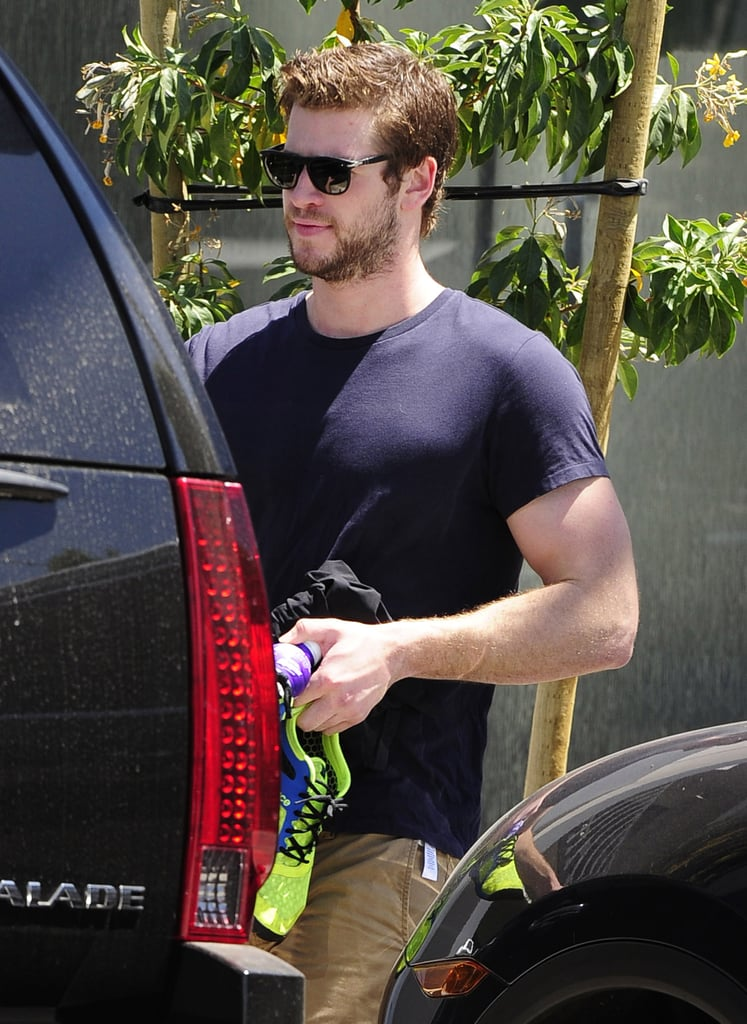 "Liam Hemsworth stepped out in LA today carrying a pair of running shoes after rumors that he and Miley Cyrus called off their engagement after months of back-and-forth publicity regarding their relationship status. Even though reports claim that the couple is ""definitely over,"" other sources reveal that Miley and Liam are still engaged, together, and ""hanging in there."" The couple still lives together in Miley's LA home and reportedly spent time together last night, but neither have directly commented on the rumors.  While Liam continues his workout routine, Miley is spending considerable time on her new album and is taking to Twitter to share updates. Miley, who is no stranger to personal posts on the social media platform, avoided addressing today's rumors, but she did post a picture of what appeared to be a wedding gown on Tuesday. Since then, the singer has been heavily promoting her upcoming single, ""We Can't Stop,"" counting down to its release this Sunday during Ryan Seacrest's morning radio show."