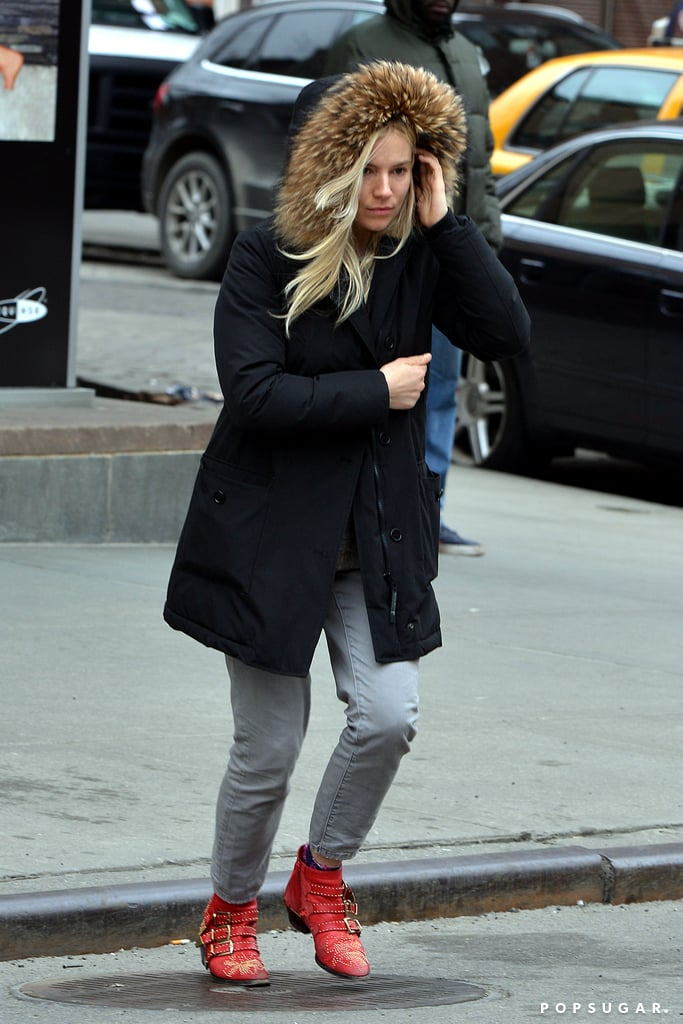 Sienna Miller wrapped herself in a fur-lined jacket for an outing in NYC yesterday. Wearing embroidered red and gold ankle boots and gray jeans, the stylish actress stopped by an ATM then hailed a cab in SoHo. Although Sienna was solo yesterday, she carried baby Marlowe Sturridge in a puffy onesie with her on Sunday when she stepped out with her other half, Tom Sturridge.  The couple are counting down the days until Tom's play, Orphans, opens on March 26. Tom will star opposite Alec Baldwin and Ben Foster, who stepped in for Shia LaBeouf after his feud with Alec reportedly led him to leave the show. Sienna will also return to the spotlight again soon as her latest film, Foxcatcher, will hit the big screen later this year. The project pairs her with Steve Carell and Channing Tatum, who attended his G.I. Joe: Retaliation premiere in London last night.