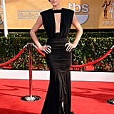 The Last Stand's Jaimie Alexander went dramatic in a black ruched Marc Bouwer gown, complete with a plunging neckline and high-low train.