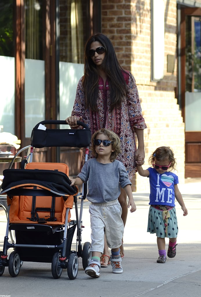 Vida and Levi wore sunglasses for a walk with mom Camila Alves.
