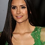 Nina Dobrev wore an Elie Saab dress with lace details.