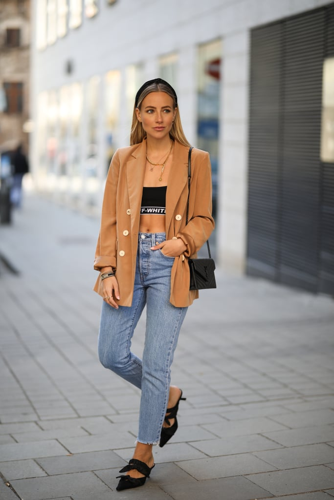 Show off some skin in a crop top, blazer, and high-waisted jeans.