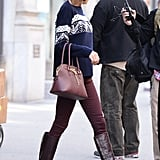 She'll Go the Matchy-Matchy Route, Complementing Her Oxblood Denim With Leather Boots and a Leather Satchel