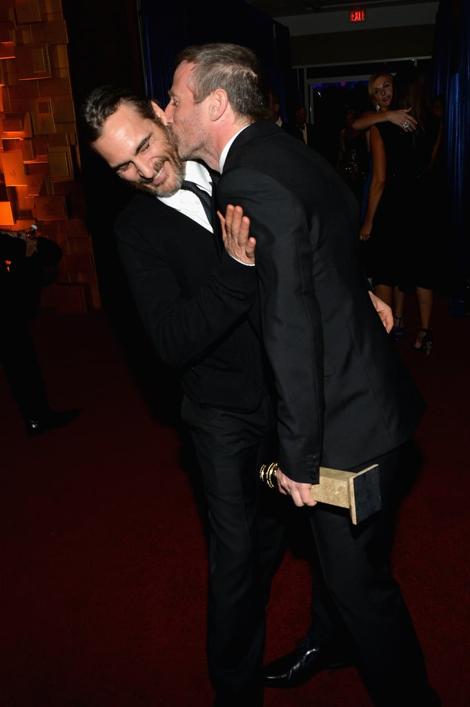 Spike Jonze kissed Joaquin Phoenix at a Golden Globes afterparty.