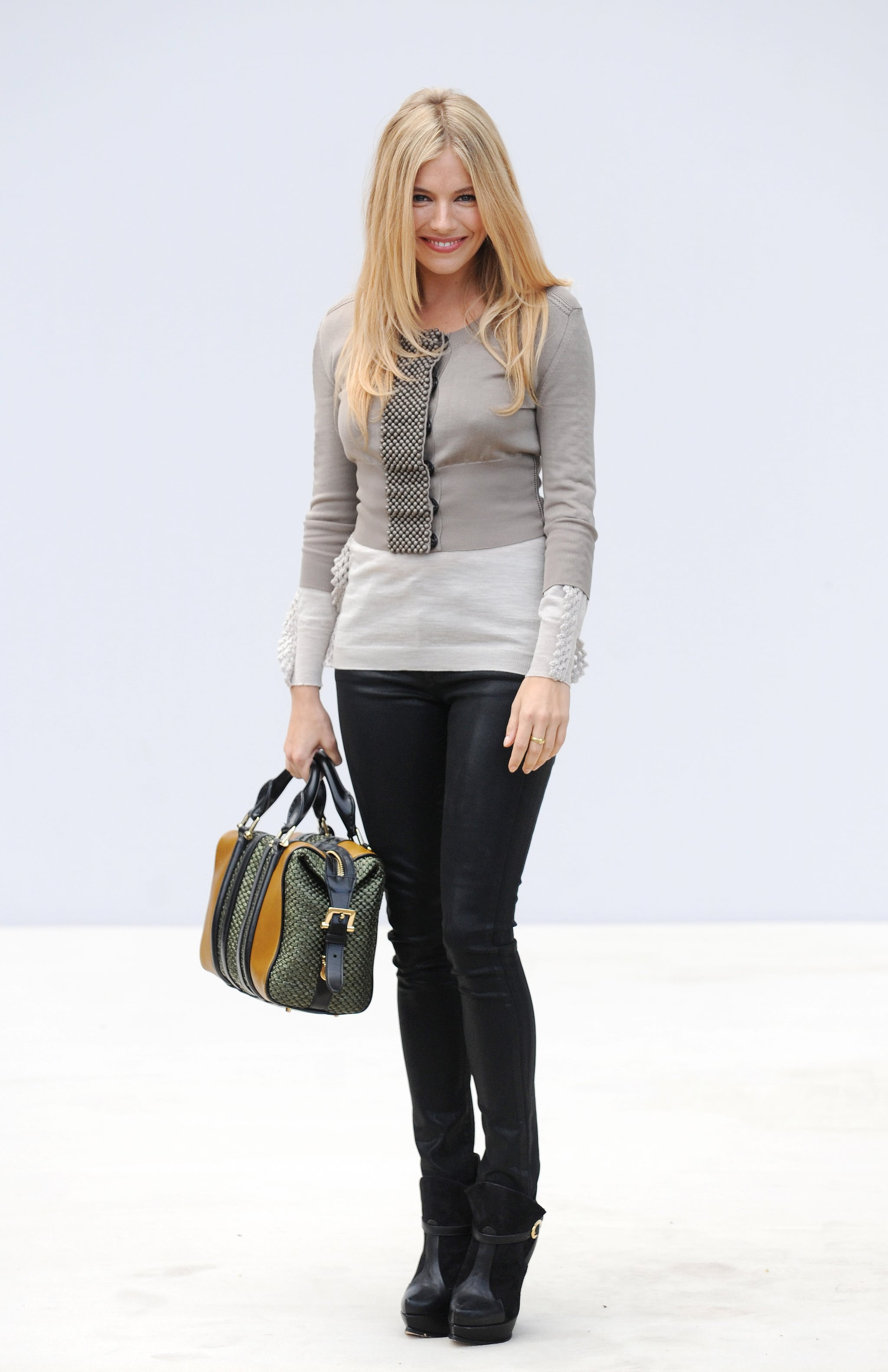 The star sported slim layers while taking in London Fashion Week's Spring 2012 runway shows.