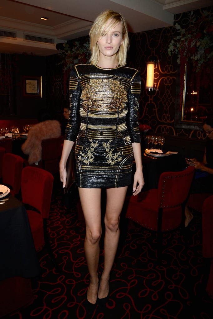 Anja Rubik heated things up in a leather LBD at the Moncler flagship opening.