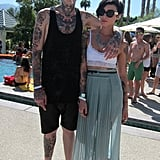The quintessential cool couple — check out those tattoos — at the H&M Coachella party.