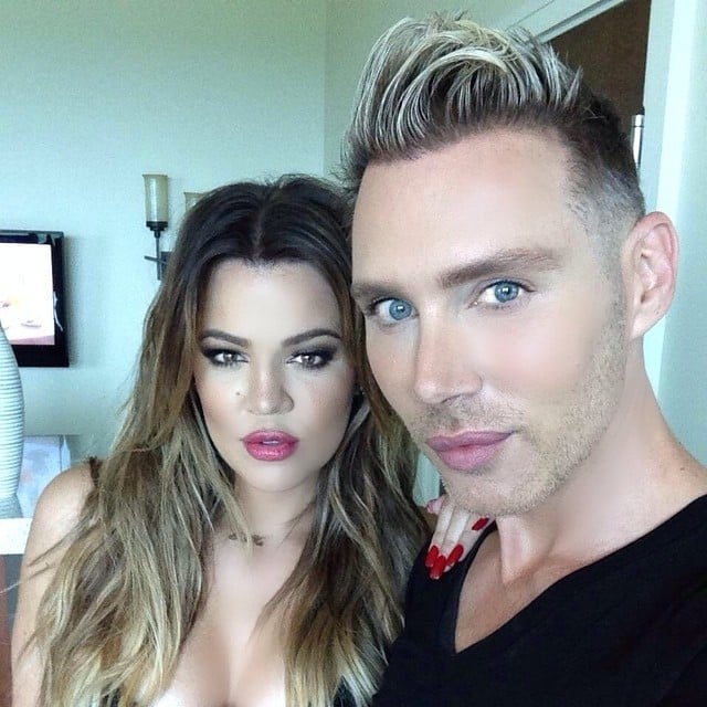Khloé Kardashian gave a fierce look to the camera with her makeup artist. Source: