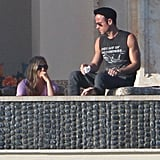 Jennifer Aniston and her fiancé, Justin Theroux, had a conversation by the pool.