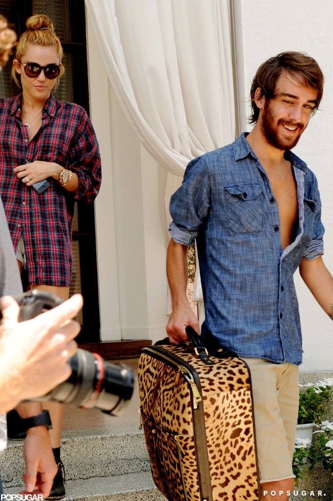 Miley Cyrus left her Miami hotel with friend Cheyne Thomas ...