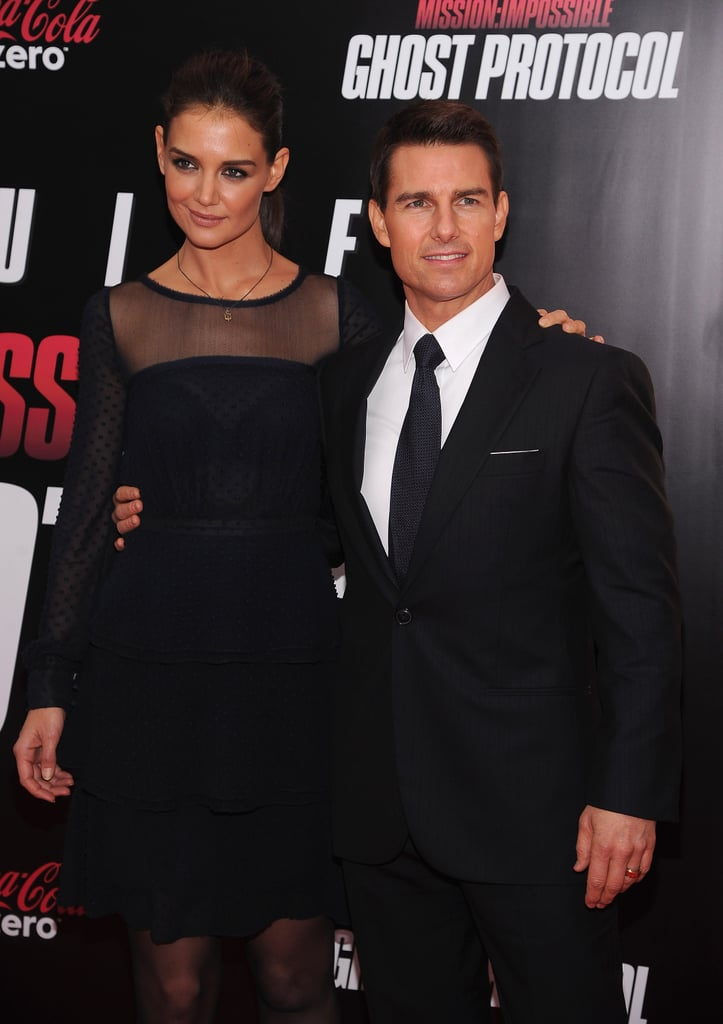 Tom Cruise hit the red carpet for the NYC premiere of Mission: Impossible — Ghost Protocol in a sexy dark suit. He's been traveling around the world with costar Paula Patton to promote the action film, and now the duo are showing off their exciting project in the Big Apple. Tom had wife Katie Holmes by his side this evening, though, and she looked gorgeous in a sheer short dress.  Tom's MI4 comes out in just a few days, but his release isn't the only big news for the Holmes-Cruise family. Katie celebrated her 33rd birthday over the weekend and spent the day with Tom and their daughter Suri. She was back out in the city for brunch with a friend at Bubby's earlier today while Tom prepped for an appearance on The Late Show With David Letterman.