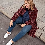 A Canadian Tuxedo Underneath a Plaid Coat With White Sneakers