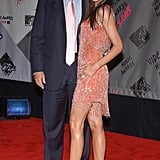 Melania's sparkling, fringed orange dress stood out with metallic sandals at the 2003 MTV Video Music Awards.